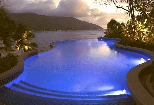 Glowing pool in the evening at Northolme Hotel, Seychelles